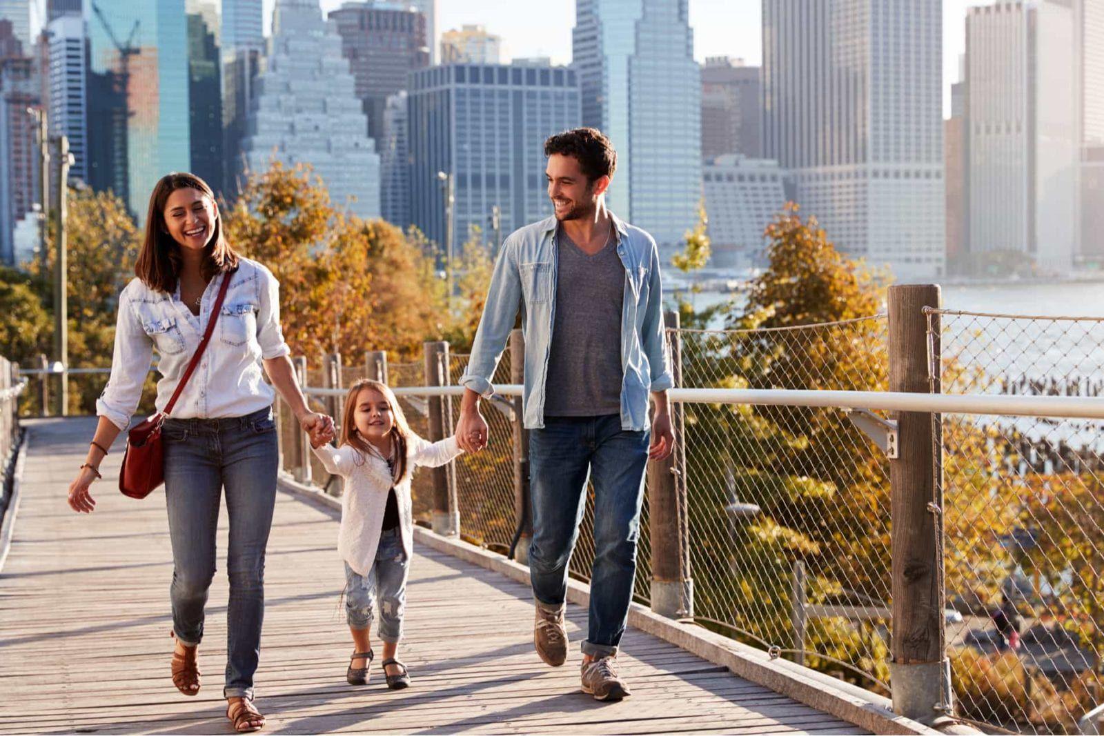 happy family walking child in long island city